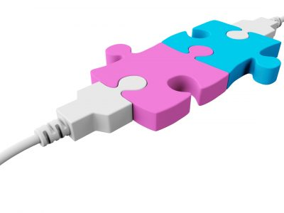 Two pieces of the puzzle are joined together and both are connected to the usb cables